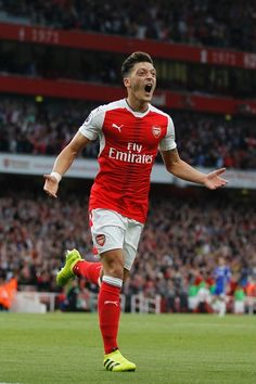 Arsenal's German midfielder Mesut Ozil celebrates scoring their third goal during the English Premier League football match between Arsenal and Chelsea at The Emirates stadium in London, on September 24, 2017. / AFP / IKIMAGES / Ian KINGTON / RESTRICTED TO EDITORIAL USE. No use with unauthorized audio, video, data, fixture lists, club/league logos or 'live' services. Online in-match use limited to 45 images, no video emulation. No use in betting, games or single club/league/player…