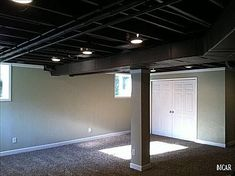 So this is just a basement but instead of finishing the ceiling and enclosing the space more they allowed it to feel more open and updated by doing a simple sealant/paint in black! Cheaper easier and in some basements more practical! - March 02 2019 at Basement Apartment, Apartment Renovation, Basement Bedrooms, Basement Bathroom, Basement Laundry, Laundry Room, Unfinished Basement Ceiling, Low Ceiling Basement, Unfinished Basements