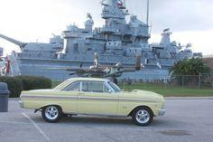 1965 Ford Falcon. Battleship USS Alabama in background