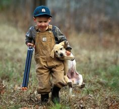sweet little boy and his puppy(: