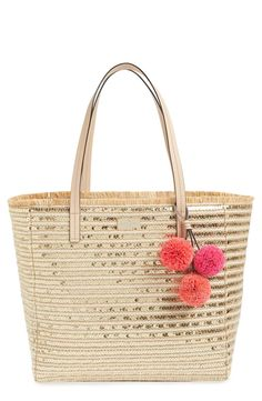 A glam take on a classic beach style, this woven tote from Kate Spade is covered in sequined stripes. Ideal for toting to the pool or beach!
