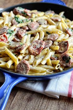 Turkey Sausage Alfredo with spinach and sundried tomatoes. Recipe at TidyMom.net