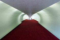 The TWA Flight Center at New York's John F. Kennedy Airport is probably the best-known airport building in the world. During its operational life it served as the home of the legendary Trans World Airlines (TWA). Glass Ceiling, Ceiling Lights, Twa Flight Center, 1960s Interior, Kennedy Airport, Sky Walk, Airport Design, National Airlines, Concrete Walkway