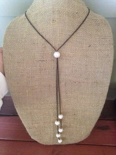 Leather and Pearls Necklace. One HUGE (15mm) Freshwater pearl slides making this simple, sleek piece adjustable. Perfect for your winter necklines and sweaters as you can position the sliding pearl wh