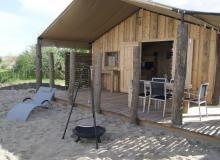 Zeeland vakantiehuisjes bij Renesse 250m van het strand af. Kinderanimatie, bioscoop, restaurant met open haard