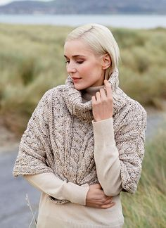 Wool Cape Oatmeal Speckle: Featuring a modern speckle pattern and traditional cable knit design, the Wool Cape Oatmeal Speckle is a must have statement piece for any wardrobe. A twist detail at the bottom of thiscapemakes itan elegant accessoryto take you from daytime to nighttime. #aran#capelet#cableknit#wool#knitwear#fashion#style#winteroutfits#rustic#elegant#womenswear#fallfashion#aw17#fisherman#styleirlandiase #patrickfrancis #cape
