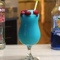Frozen Blue Raspberry Frozen Blue Raspberry The Frozen Blue Raspberry is a little slushy, boozy dream. This stunning blue cocktail combines raspberry vodka, blue curacao, orange juice, Raspberry Vodka Drinks, Raspberry Margarita, Raspberry Cocktail, Pineapple Cocktail, Raspberry Liqueur, Frozen Drink Recipes, Frozen Drinks, Cocktail Recipes, Yummy Drinks