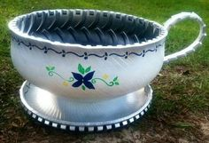 Old tire teacup planter