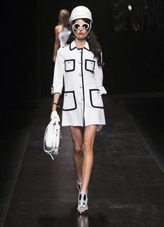 This modern runway garment pulls various elements for the late 1960's during the space age revolution.  During this time space travel was a a big topic within the media and it reflected on fashion.  This modern garment reflect some of those elements from the 1960's such as Pierre Cardin's Iconic helmet. 3/23/15
