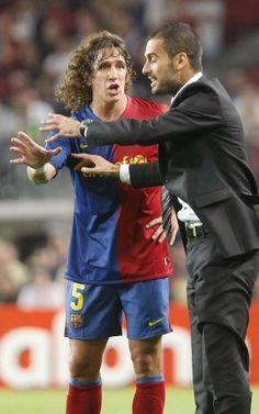 Puyol recibe instrucciones de Pep Guardiola