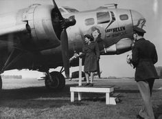 "Lieutenant Helen Pierson, an army nurse assigned to the 163d General Hospital at Wimpole Hall- an 8th Air Force hospital- near Bassingbourn, christens a B-17 Flying Fortress of the 91st Bomb Group named ""Lady Helen of Wimpole"" in her honor. She later married 401BS CO John Davis ~"