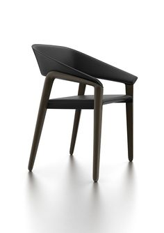 Essential and fluid shapes characterize an object full of collective memory, comfort and elegance.Upholstered seat, wooden legs.Company: Potocco, ItalyYear: 2012