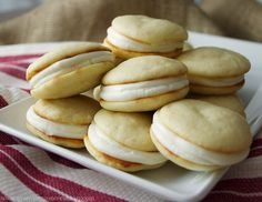 Lemon Sandwich Cookies A cake-like lemon cookie with a cream cheese frosting in the middle is such a delicious idea, isn't it? From Dionne, Try Anything Once Culinary Lemon Desserts, Lemon Recipes, Sweet Recipes, Delicious Desserts, Yummy Food, Summer Recipes, Lemon Sandwich Cookies Recipe, Lemon Cookies, Yummy Cookies