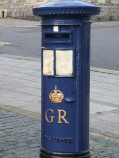 Historic British post boxes.  There was a period where blue post boxes were briefly in vogue. These boxes, such as this George V example, which stands outside Windsor Castle, were for air mail. They were introduced to tourist venues between 1930 and 1938. However, having separate air mail boxes proved to be too costly and in 1938 the Royal Mail decided  any box could be used to post air mail. The Windsor box is now a tourist attraction only, and can no longer be used.
