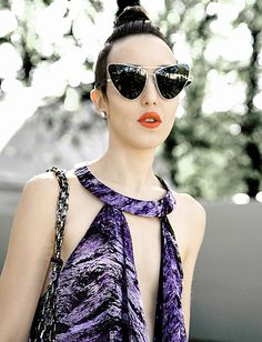 The juxtaposition of her fair skin and the deep purple with those crazy space glasses is lovely to behold.