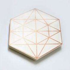 Xenia Taler's latest tile/trivet range is GORGEOUS. I love all of the copper and gold detailing and the geometric shapes