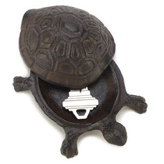 Turtle Key Hider Tuck this tiny turtle into a quiet corner beside your door and he'll keep your spare key safe and out of sight! A charming addition to your outdoor décor with a fabulously functional side too! Hide A Key, Cast Iron, It Cast, Key Safe, Outdoor Statues, Garden Statues, Tiny Turtle, Secret Storage, Tool Storage