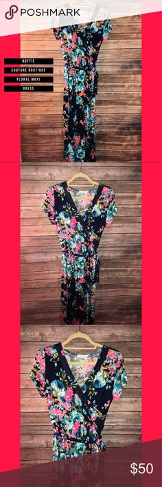 DCB navy floral maxi dress (nwot) 🌸 Silky material. Elastic waist with tie detail. Cute front crossing detail as well. Super cute for spring and fall! Tall girls can wear with flats and short girls can rock it with wedges or heels. Soooo cute Posh girls!! 🌸 Dottie Couture Boutique Dresses Maxi
