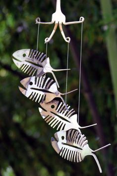 Welcome to the home of the original Spoonfish wind chimes as seen on Time Warner Cables - Made in the Carolinas  This unique new version of our Original Spoonfish Wind Chime features 4 rustic patina Bonefish made from up-cycled silver plated flatware. The Bonefish are suspended from a silver plated fork aged to the same beautiful rustic hues.  This metal mobile makes a wonderful weather-proof addition to any collection of outdoor Halloween decorations or simply ads variety to your Nautical…