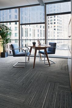 Ceremony Collection | CE172 | Color: Origami | Installed: Herringbone in a focus area / small meeting space. Private office area with dark carpet and a skyline view for a peaceful space where individuals can go to concentrate and think. Skinny planks provide flexibility in creating herringbone / chevron floor patterns for commercial spaces.