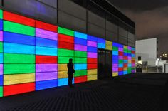 This is a concrete wall built in Germany that contains optical fiber and color-changing technology within the concrete blocks!