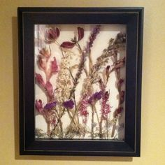 My brainstorm for what to do with dried flowers from special occasions. Instead of having them collect dust and fall apart over time, I made a display with a wall shadow box and it turned out so beautiful! These are from my father's funeral 4 years ago...