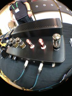A crazy fish-eye photo of ALO's new Studio Six reference headphone amplifier at T.H.E. Show in Newport. Buy it for $4,900 on our new website.