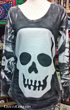 """I was at Dollar Tree recently and came across these giant felt skulls in the Halloween section. Hello, can you say """"reverse stencil?""""  All you need is the felt skull (if you can't find one, cut your own on a large piece of watercolor paper),  a white shirt, Tulip Fabric Spray in black and a piece of cardboard to go inside the shirt while you spray."""