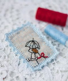 Square embroidered brooch