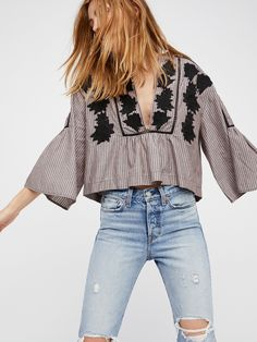 Liya Embroidered Tunic   Cute cotton striped tunic featuring femme floral embroidery throughout and a subtle crochet accent at the V-neckline.      * Flared sleeves    * Boxy, cropped shape