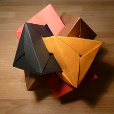 Four Interlocking Triangular Prisms and many more neat origami designs. Have fun you older kids!  Mostly looking for the hexiflexigon.