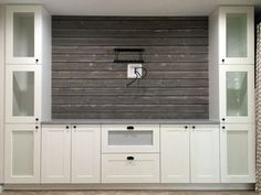 Here's a little hack I made from IKEA GRIMSLÖV kitchen cabinets, turning them into a shiplap entertainment center. We initially wanted our favorite carpenter friend to build a custom wall unit for us, but he was too busy at the time. So I knew I had to do Ikea Kitchen Cabinets, Built In Cabinets, Tv Cabinets, Wall Cabinets Living Room, Ikea Kitchens, Storage Cabinets, Ikea Bar Cabinet, Living Room Wall Units, Ikea Kitchen Remodel