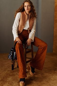 See by Chloé Pre-Fall 2016 - Look 15 - camel quilted zippered vest, white top, burnt orange flared pants with ripped layer