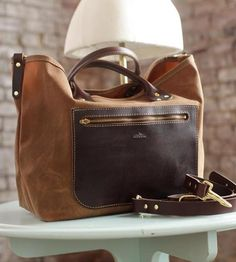 Ruggedly handsome in hardwearing materials, this waxed canvas tote bag is at home on subway commutes and cabin getaways alike. The weather resistant canvas is trimmed in chocolate leather from the Horween tannery, and has a rich, smooth finish. Simply throw in your dopp kit, a change of clothes and some reading material to take your trip on the road. And if you'd like, you can add on the optional strap for extra carrying options.