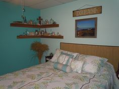 beach themed guest bedroom with using a beach mat for a head board and decorating with old jars and shells