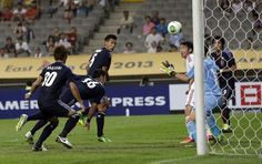 Japan's Yuzo Kurihara, second from left, scores a goal against China during their East Asian Cup soccer match at Seoul World Cup stadium in Seoul, South Korea, Sunday, July 21, 2013. http://www3.daylife.com/photo/06GXg8XaU7fZp