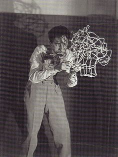 Man Ray, Jean Cocteau sculpting his own head in wire, c. 1925