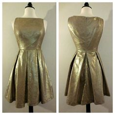 """Muse Gold Laser Cut Fit n' Flare Skater Dress NWOT. Approximate measurements: Length - 33"""" Waist laid flat - 13.5"""" Armpit to armpit laid flat - 17"""" Zip back closure. Fully lined. Muse Dresses"""
