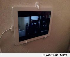 """My $2 solution to """"I want to watch Netflix in bed but my arms get tired from holding my iPad""""."""