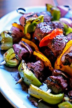 These filet mignon shish kabobs use beautiful chunks beef marinated in red wine, shallots, dijon mustard along with fresh herbs overnight. Charred to perfection with fresh bell peppers and onion.
