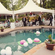 Wedding decorations floating in a pool Photo by Alea Moore Photography