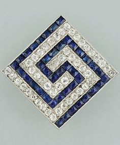 An Art Deco sapphire and diamond brooch, circa 1930. The square-shaped gold and platinum topped panel with calibré sapphire and brilliant-cut diamond key pattern design the sides with repeated key pattern engraved detail, later brooch pin. #ArtDeco #brooch