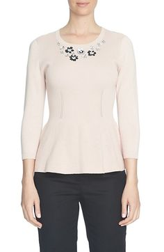Free shipping and returns on CeCe Embellished Neck Peplum Sweater at Nordstrom.com. Clusters of floral embellishments sparkle and shine on the yoke of a three-quarter-sleeve sweater knit from soft combed cotton. Openwork stitching, contoured ribbing and a peplum hem create flattering waist-nipped dimension for a cozy yet elegant look.