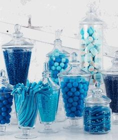 Here's an example of a blue candy bar!  I'd add some peacock colored ribbon bows here and there.  destinationweddings.travel