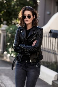 Leather jacket, black jeans, rimless sunnies? This IS the rocker girl style. Via Sara Donaldson