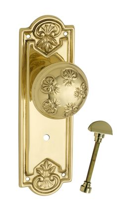 Tradco Hardware 'Nouveau' Knob on back plate with privacy snib (1053P)  in polished brass finish www.tradco.com.au
