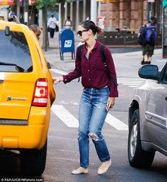 877bae2baa6 Familiar scene  Katie Holmes was spotted out in New York on Friday wearing  her favourtie pair of ripped jeans and a red and blue plaid shirt