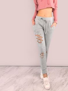 """Rock that wear and tare look with these bottoms. Featuring sweatpants with distressed detailing, tieable drawstring with an elastic waistband and two pocket design. Pants measure 39"""" in. from waist to bottom hem. Throw on a matching crop top or pair it with a knotted white tank. #sporty #MakeMeChic #style #fashion #newarrivals #fall16"""