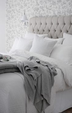 This is what I like: lots of pillows, white, and some simple color.