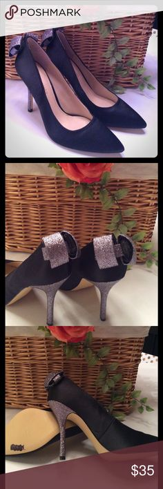 """🌸ENZO ANGIQLINI🌸BLACK SATIN HEELS GORGEOUS BLACK SATIN 4"""" HEELS WITH SILVER SEQUINS BOW AND HEEL ON BACK. NEVER WORN SO IS IN EXCELLENT CONDITION. SIZE 9 1/2 M. PAPADILLA TEXTILE UPPER BALANCE MAN MADE IN CHINA. Enzo Angiolini Shoes Heels"""